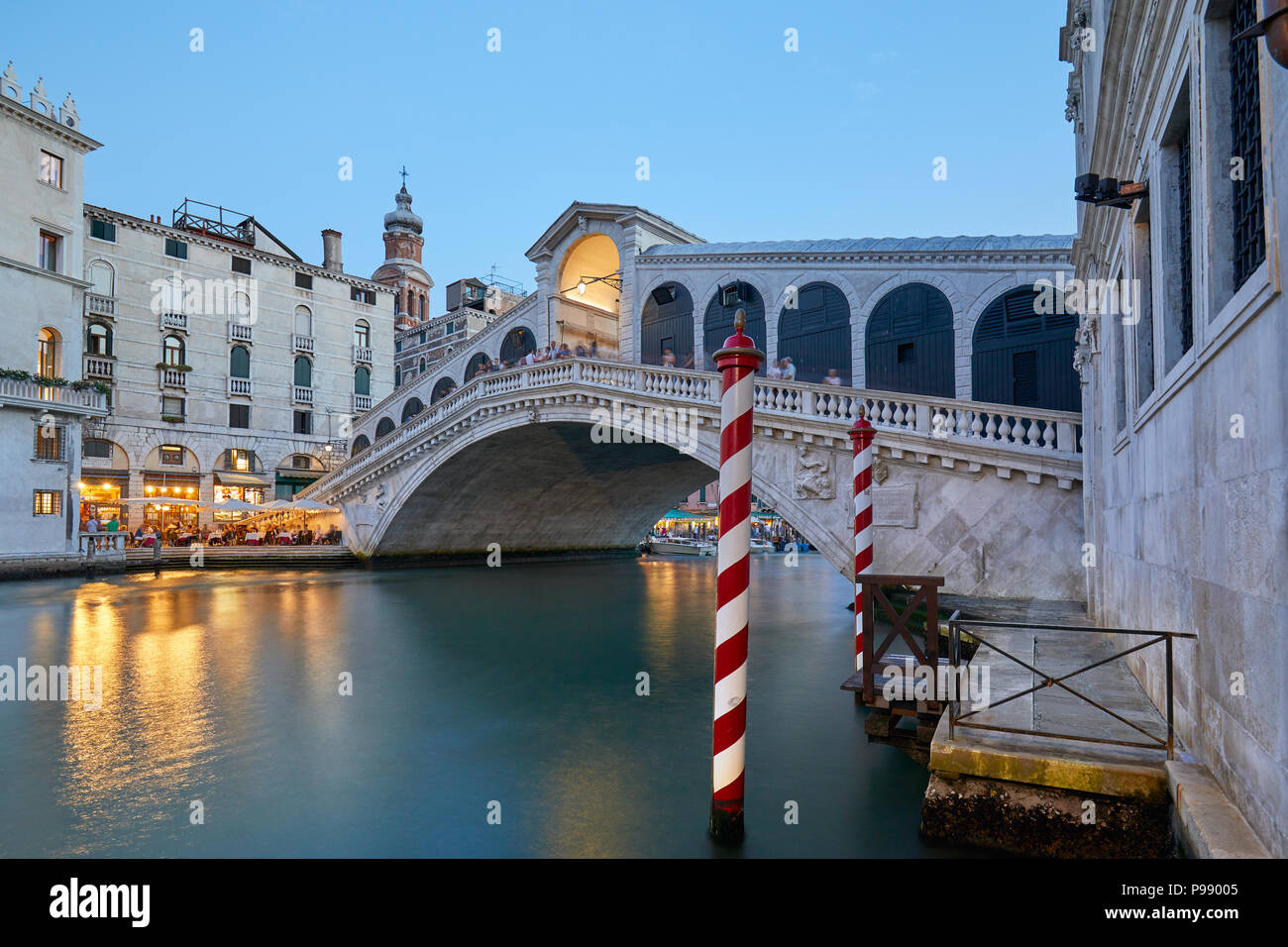 The Grand Canal and Rialto bridge with people, evening in Venice, Italy - Stock Image