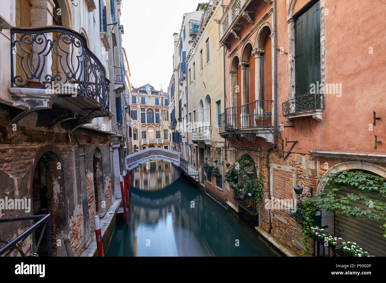 Venice canal with ancient buildings and houses facades in Italy - Stock Image