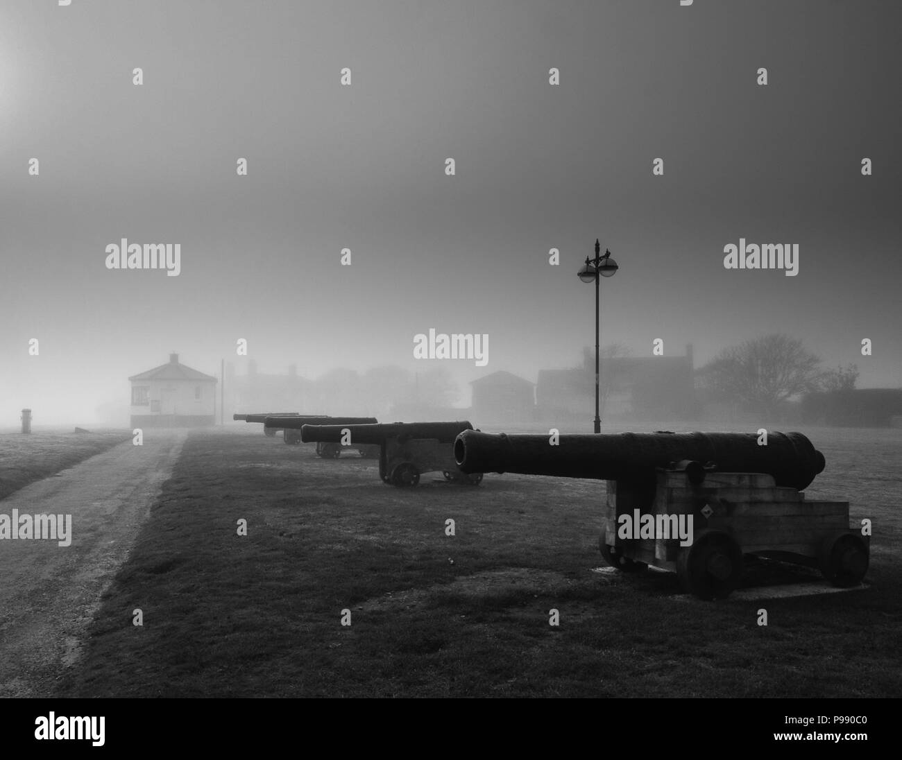 View of canons on Gun Hill, Southwold, Suffolk during a sea mist - Stock Image