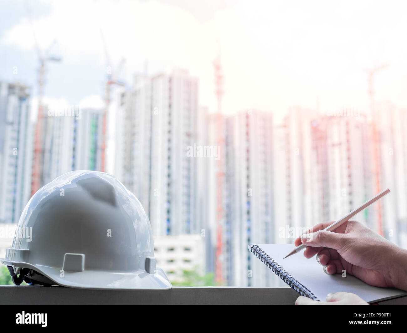 White Hard Safety Helmet For Civil Engineer Protect And Safety Hat For Engineering Worker And Hand Writing Notebook By Pencil On Construction Buildin Stock Photo Alamy