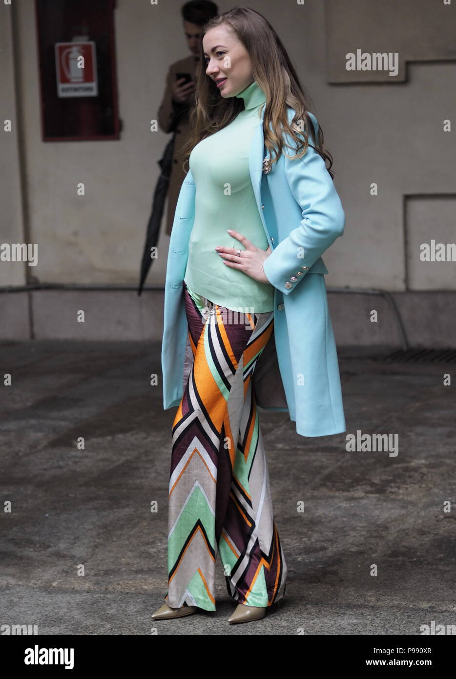 MILAN - FEBRUARY 22, 2018: Models and fashion blogger in 'Corso Magenta' 24 after and before EMILIO PUCCI fashion show - Stock Image