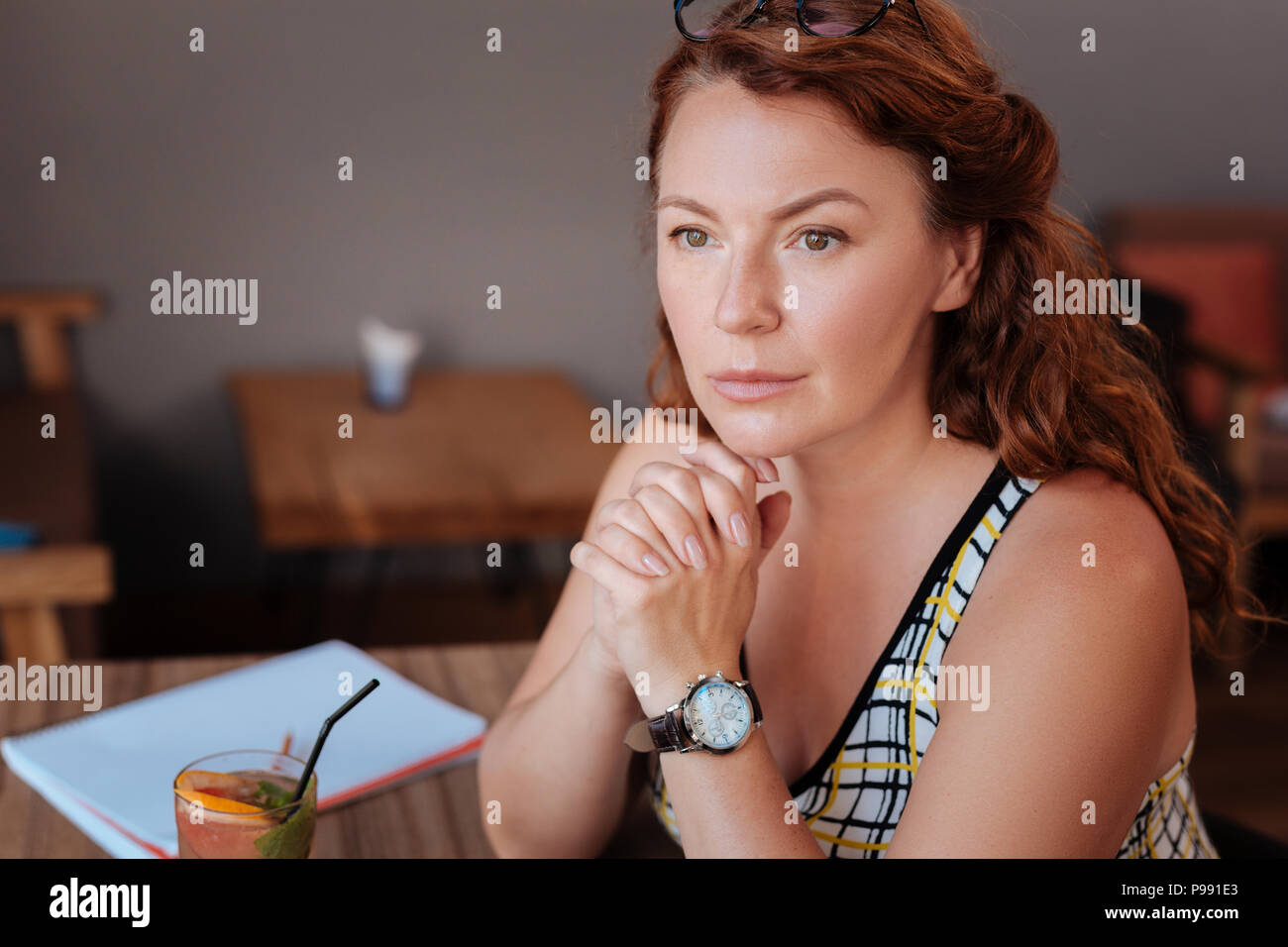 Green-eyed mature woman looking at her husband - Stock Image