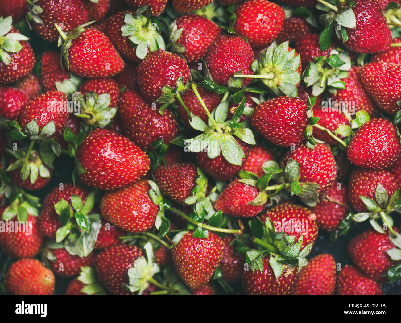 Fresh strawberry texture, wallpaper and background - Stock Image