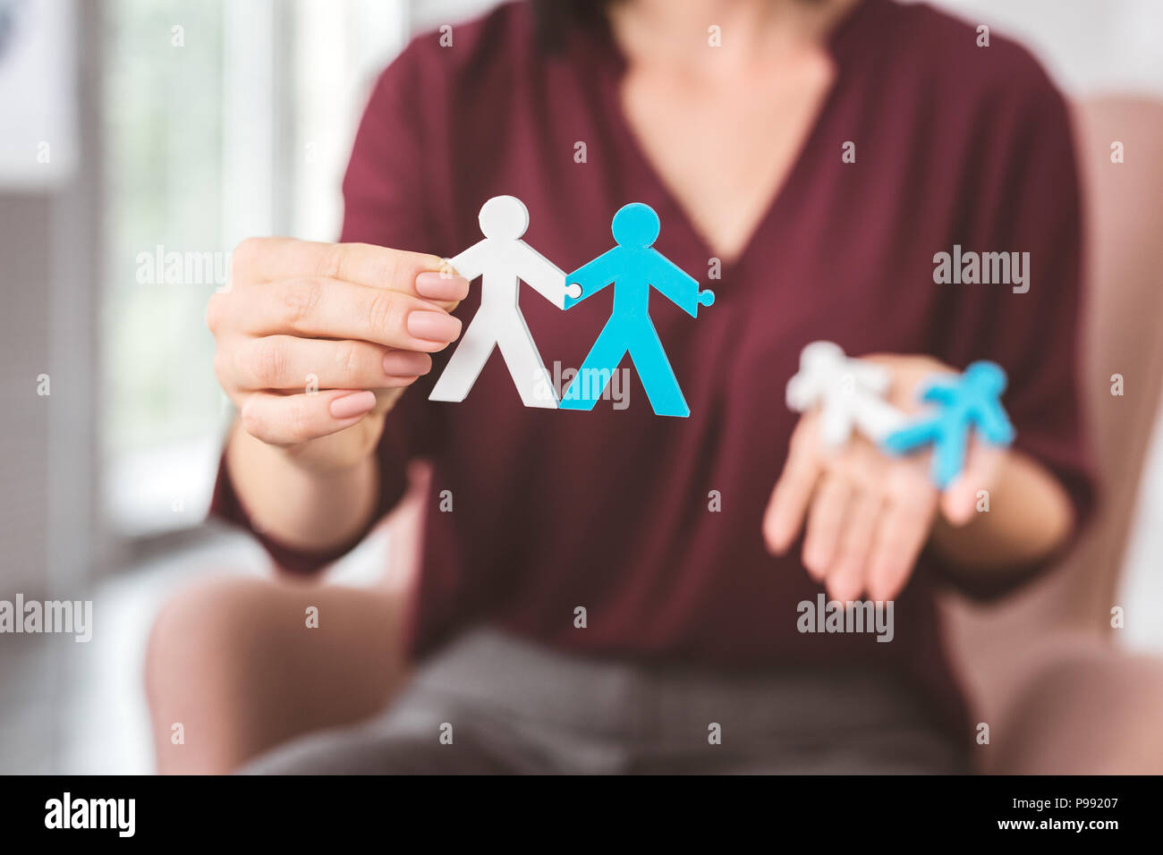 Two stickmen holding hands and giving an example of good relationships - Stock Image
