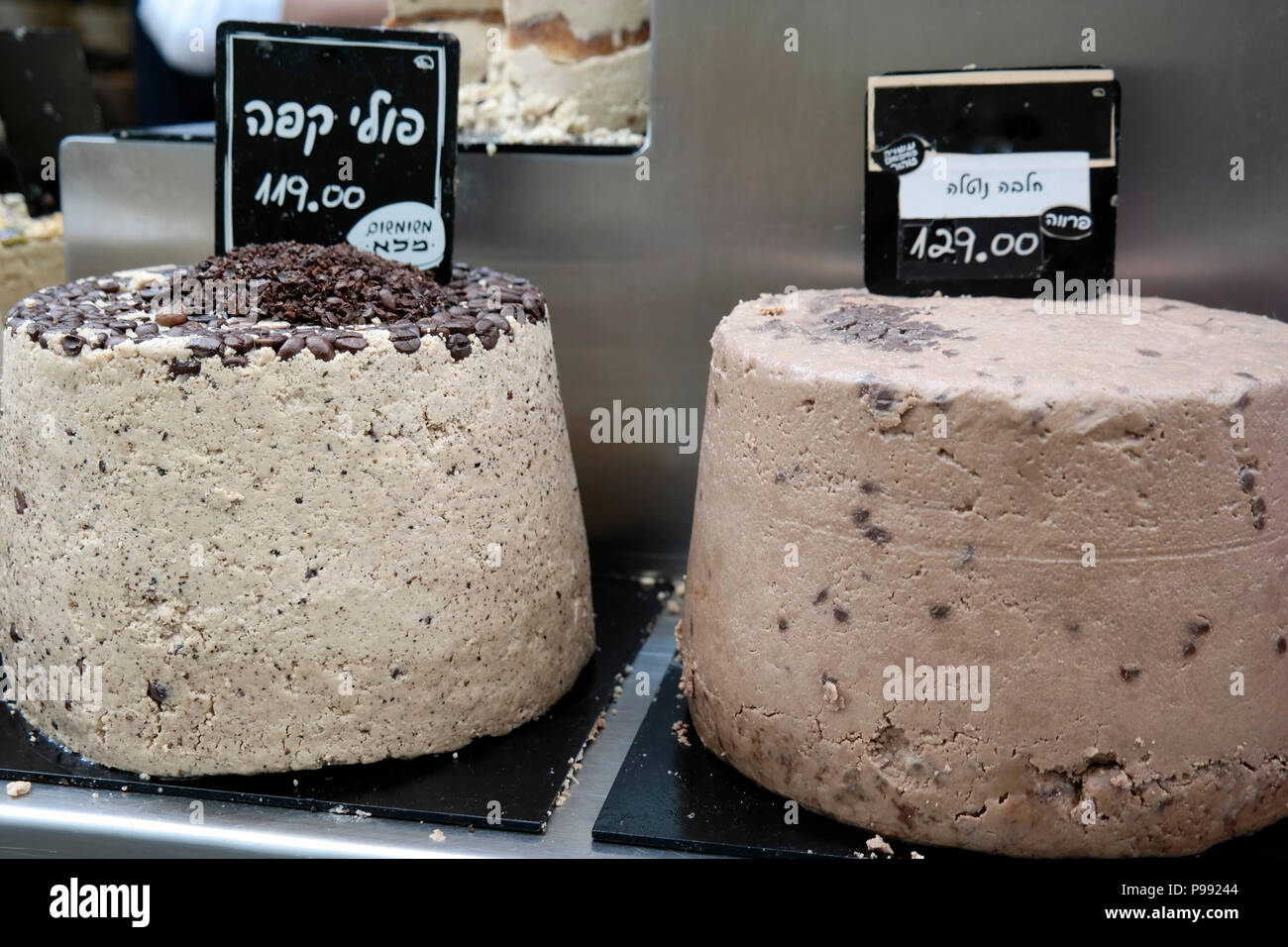 Big pieces of halva 'Halva with coffee beans' 'made of whole sesame' on s market stand - Stock Image