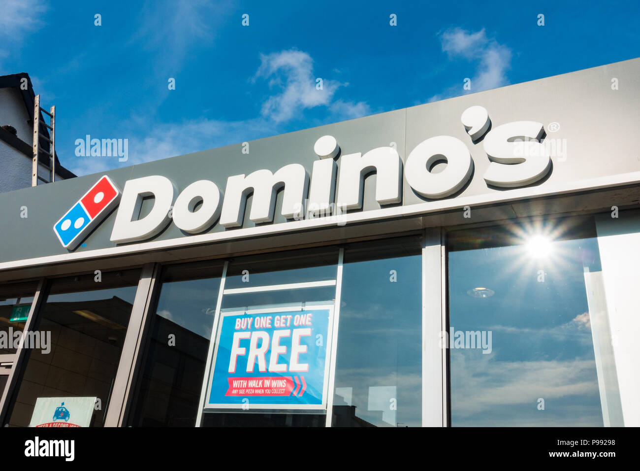 Domino's Pizza logo and sign over takeaway restaurant - Stock Image