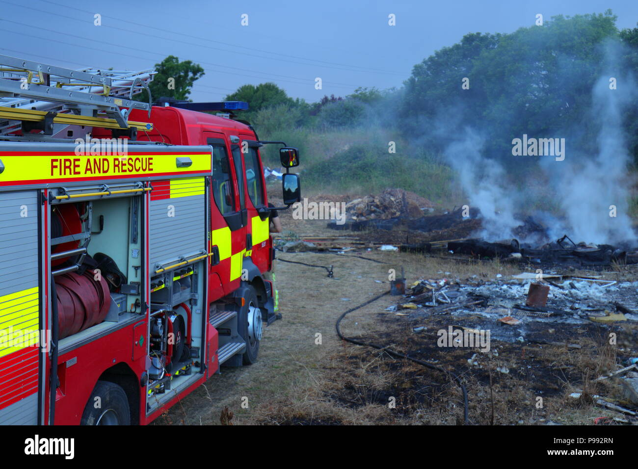 Fire crews from Selby, North Yorkshire put out a rubbish fire just off the A63 near Selby. - Stock Image