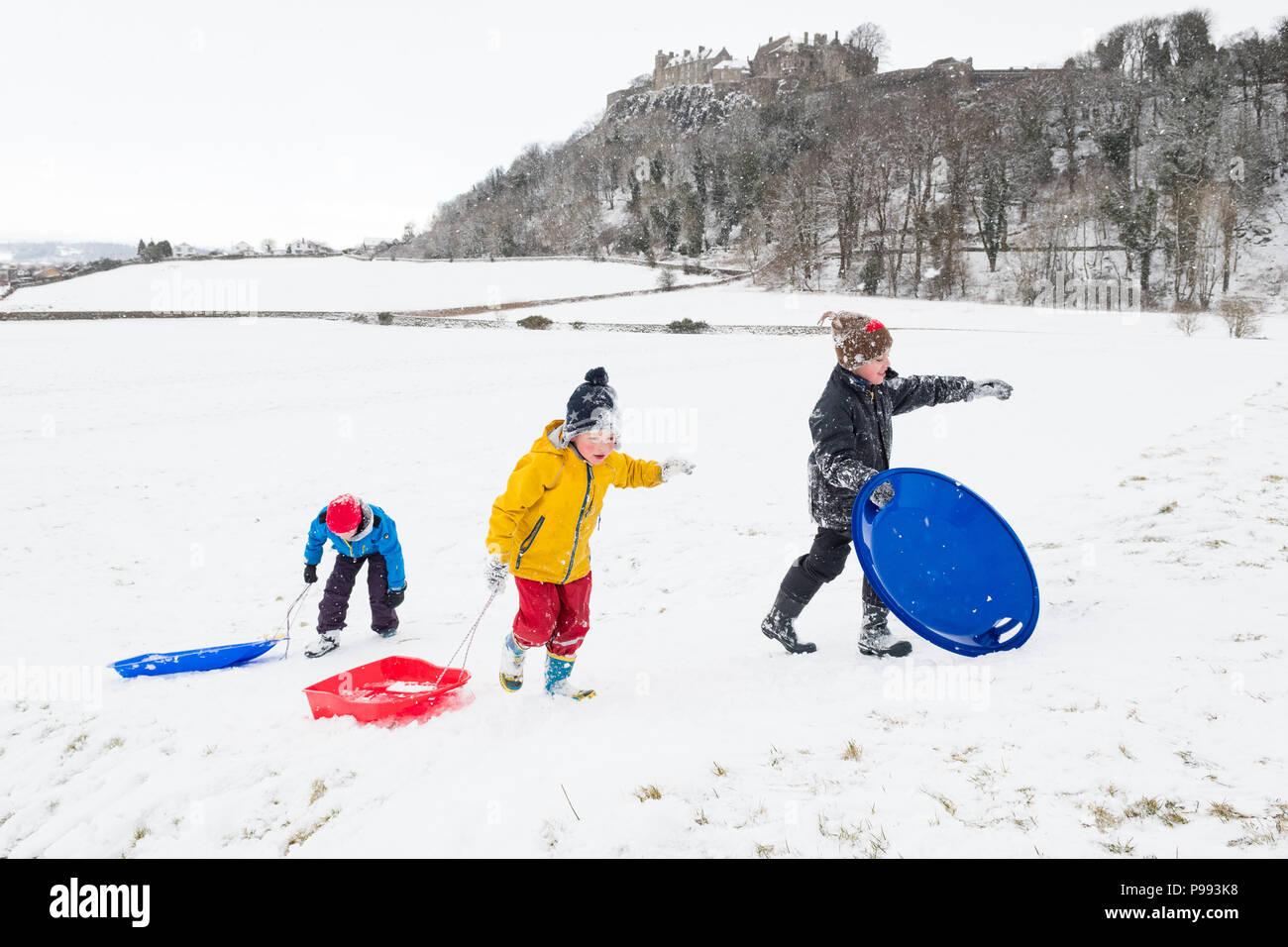 sledging below Stirling Castle, Scotland, UK - Stock Image