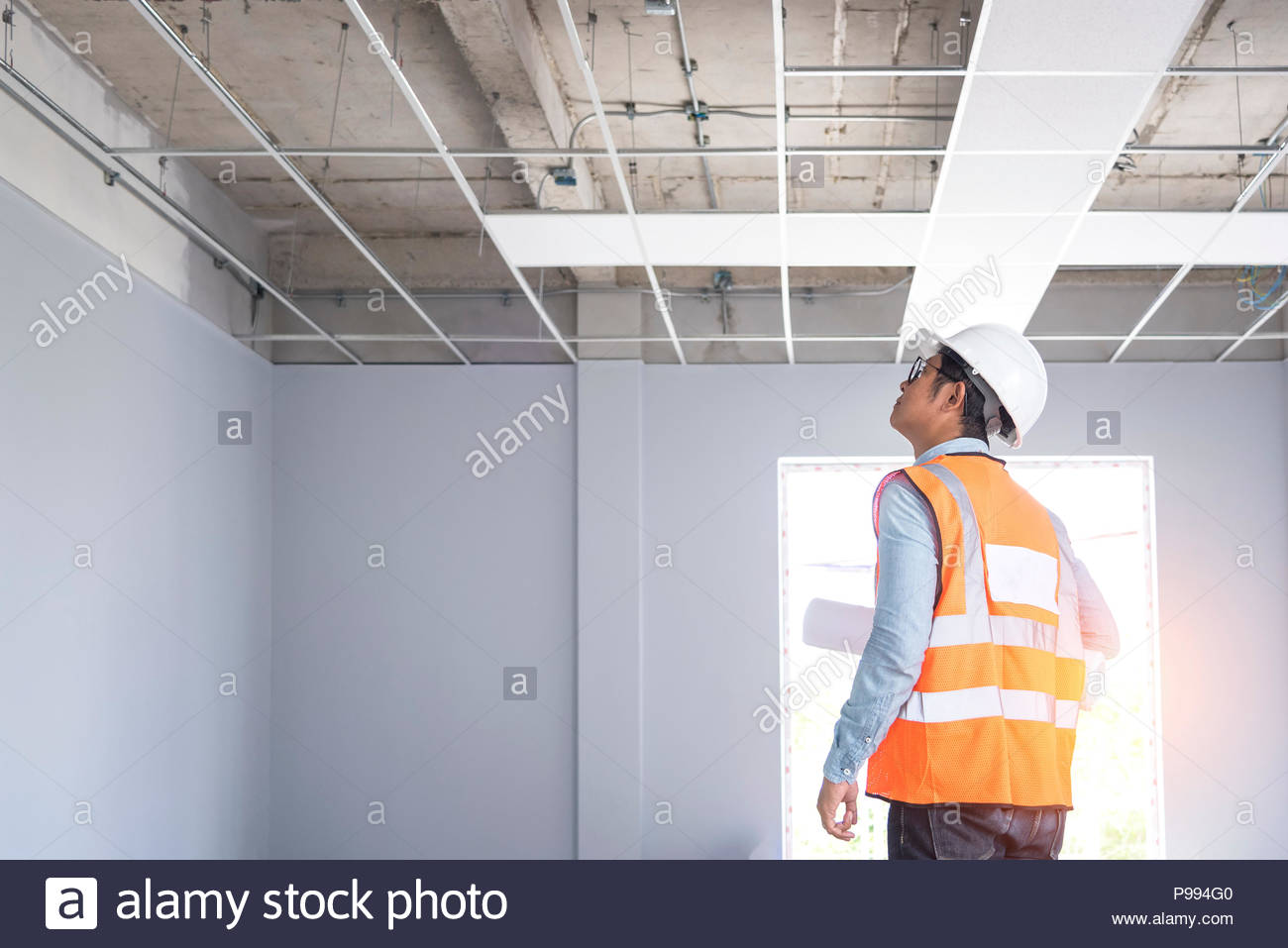 Engineer and Architect working at Construction Site with blueprint, Project quality control Stock Photo