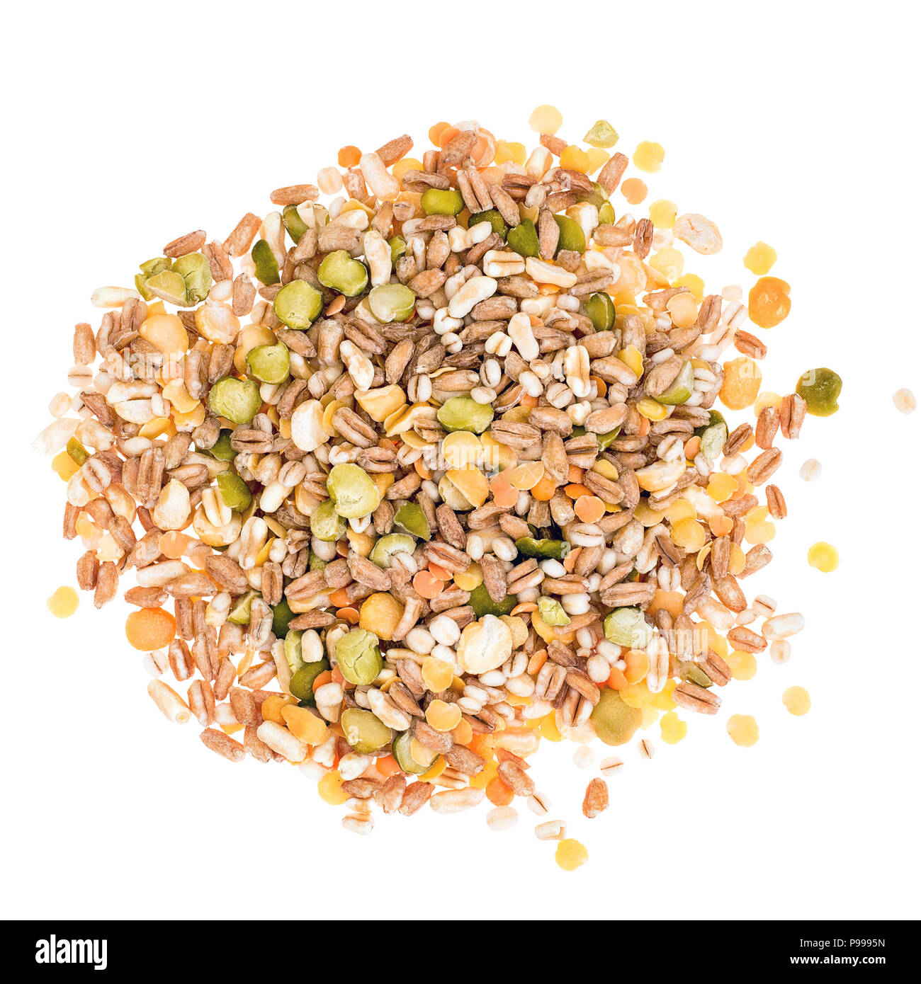 Assorted grains and pulses mix on white background, heap, top view. Winter food includes split peas, red and yellow lentils, pearl barley, kamut, spelt. - Stock Image