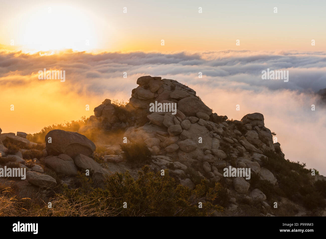 Sunrise clouds above Rocky Peak Park in the San Fernando Valley area of Los Angeles, California. Stock Photo