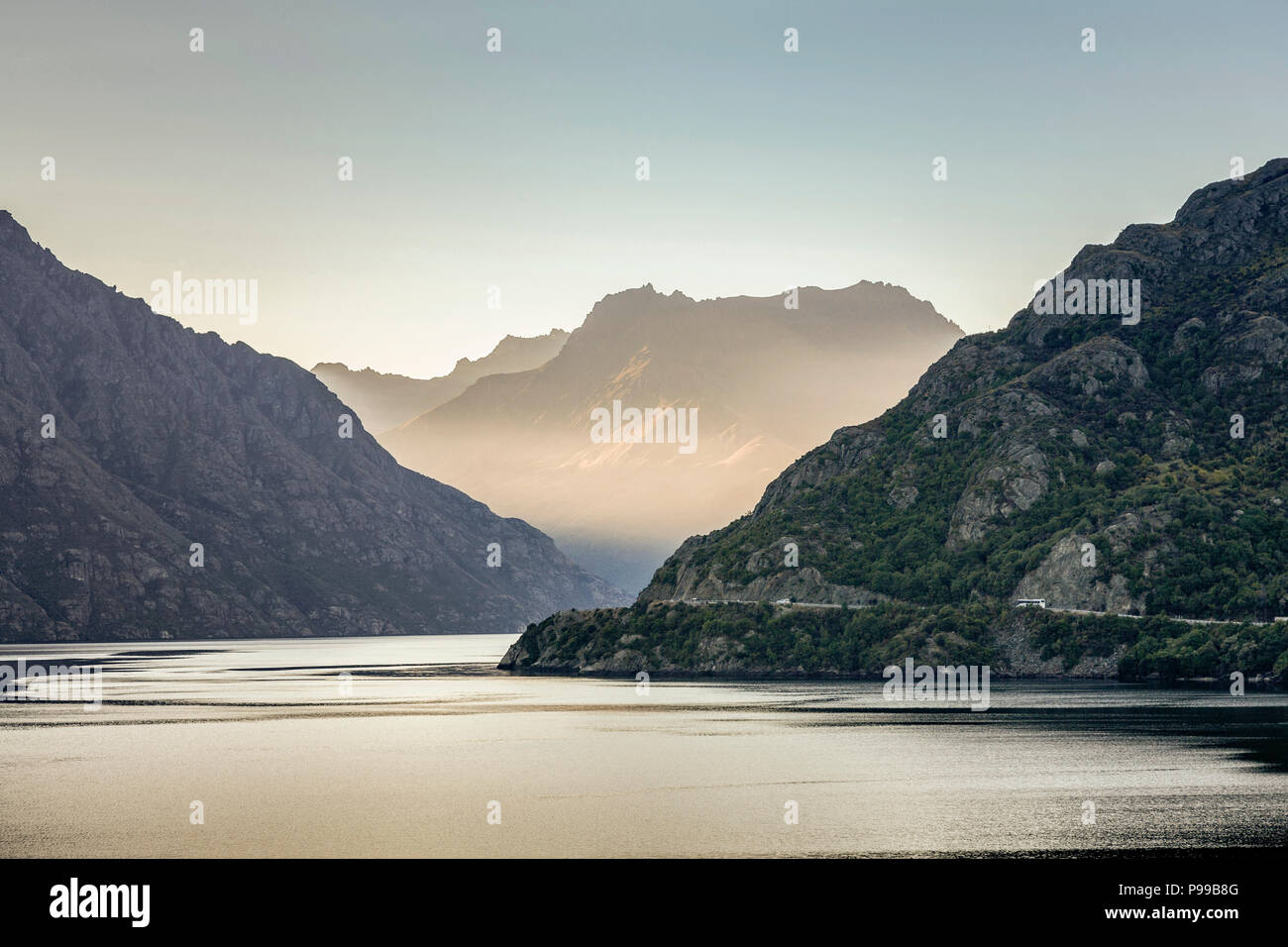 View looking north on the Kingston Arm of Lake Wakatipu, near Queenstown, New Zealand as sunset approaches. - Stock Image