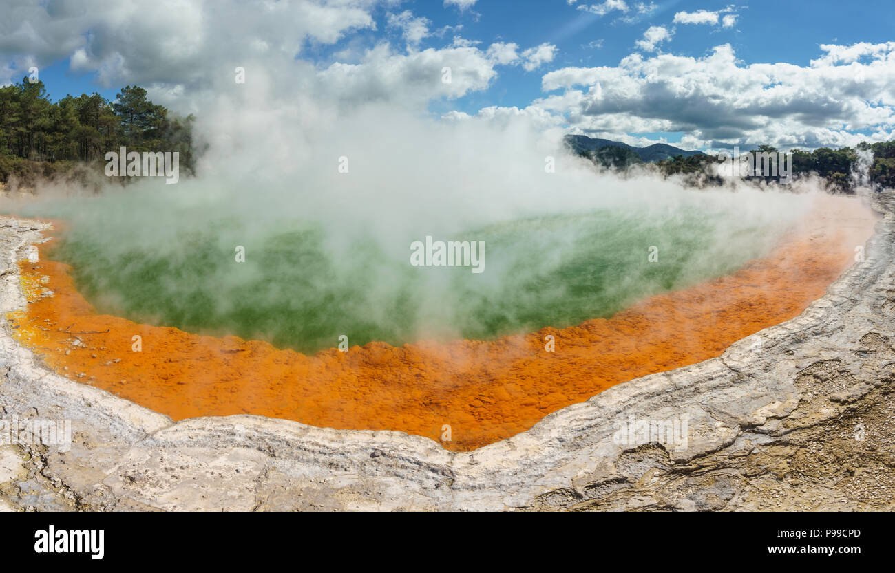 Champagne pool, a terrestrial hot spring with abundant carbon dioxide creating many bubbles, Wai-O-Tapu geothermal area, New Zealand North island. - Stock Image