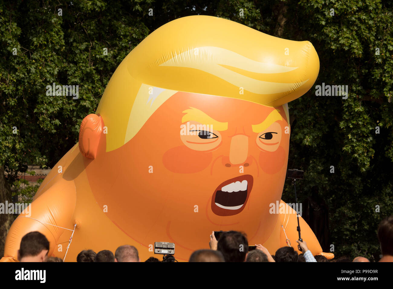 Close-up of 'Trump Baby' a giant inflatable effigy of US President Trump which was flown during protests at Parliament Square Gardens, London, UK. - Stock Image