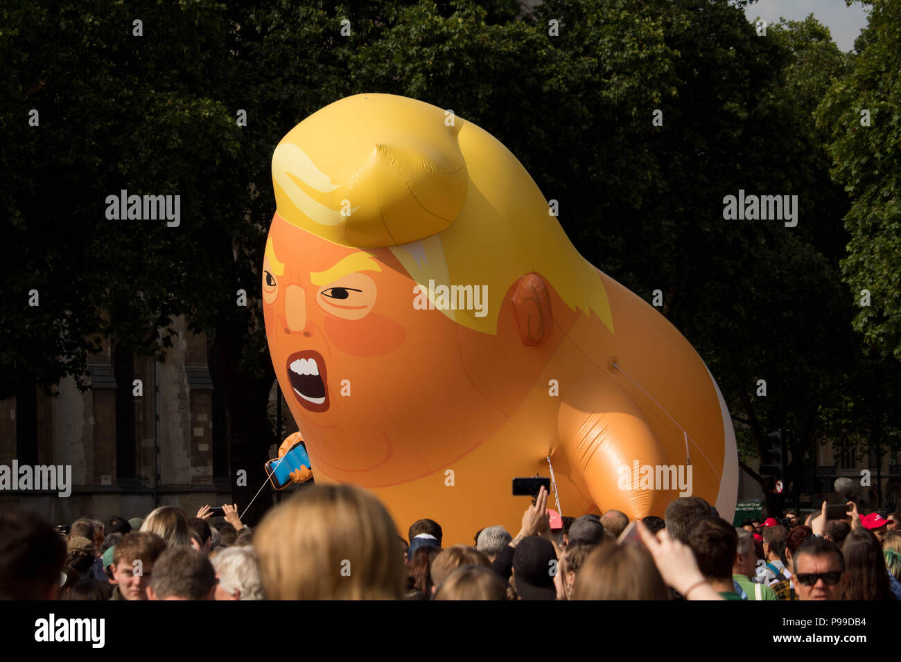 'STOP TRUMP' protest march in Parliament Square Gardens as an angry caricature of President Donald Trump faces the crowd. London, UK 13/7/18. Stock Photo