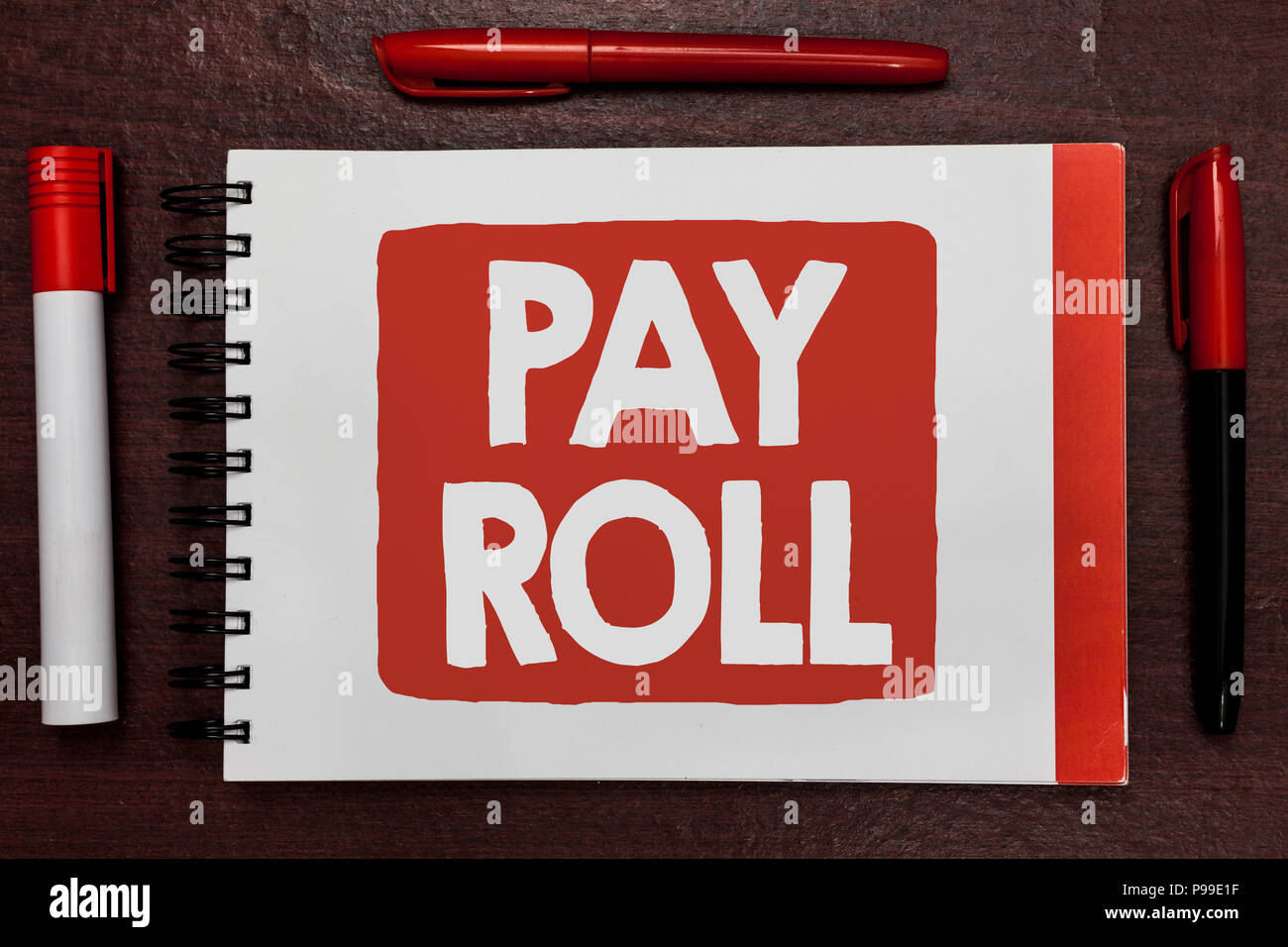 Text sign showing Pay Roll. Conceptual photo Amount of wages and salaries paid by a company to its employees Important ideas highlighted notebook mark - Stock Image