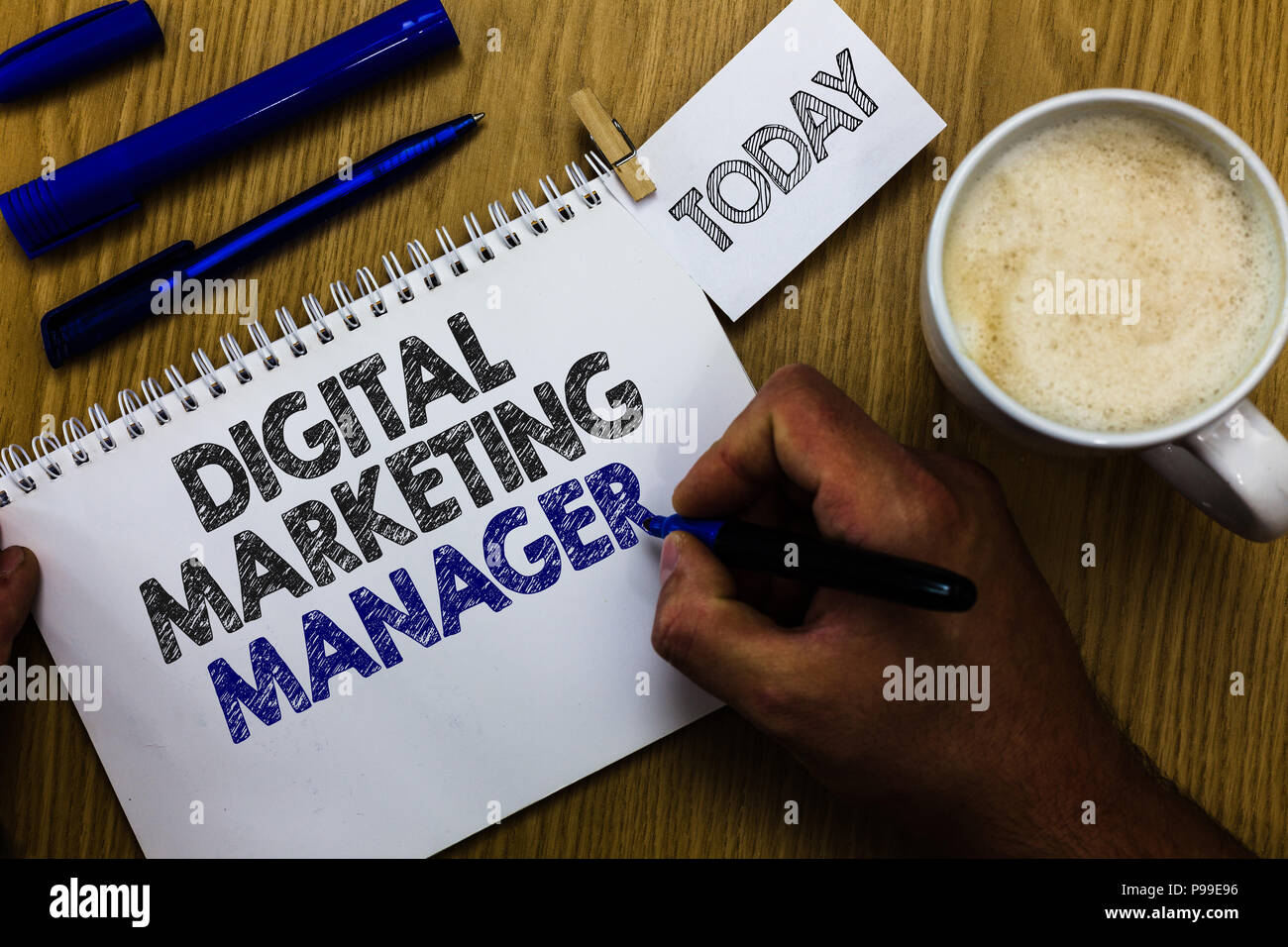 Text sign showing Digital Marketing Manager. Conceptual photo optimized for posting in online boards or careers Man holding marker notebook clothespin - Stock Image