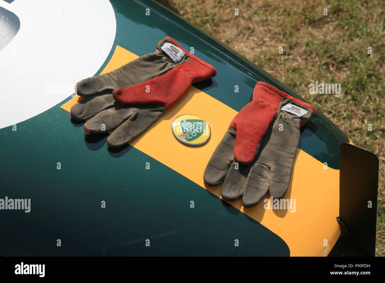 A pair of racing drivers gloves on the nose of a 1967 Lotus 51A - Stock Image