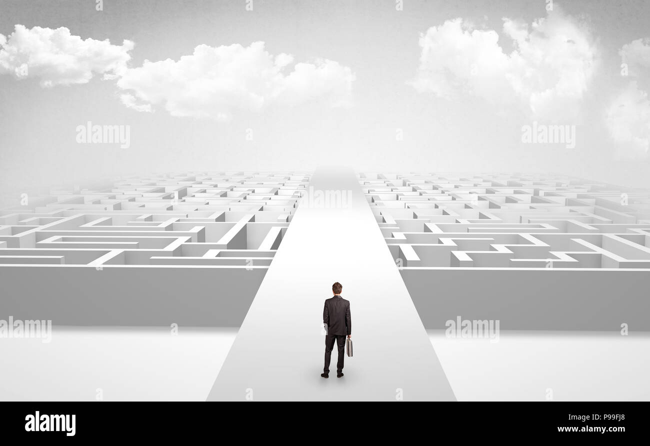 Businessman going straight ahead on a wide road between mazes  - Stock Image