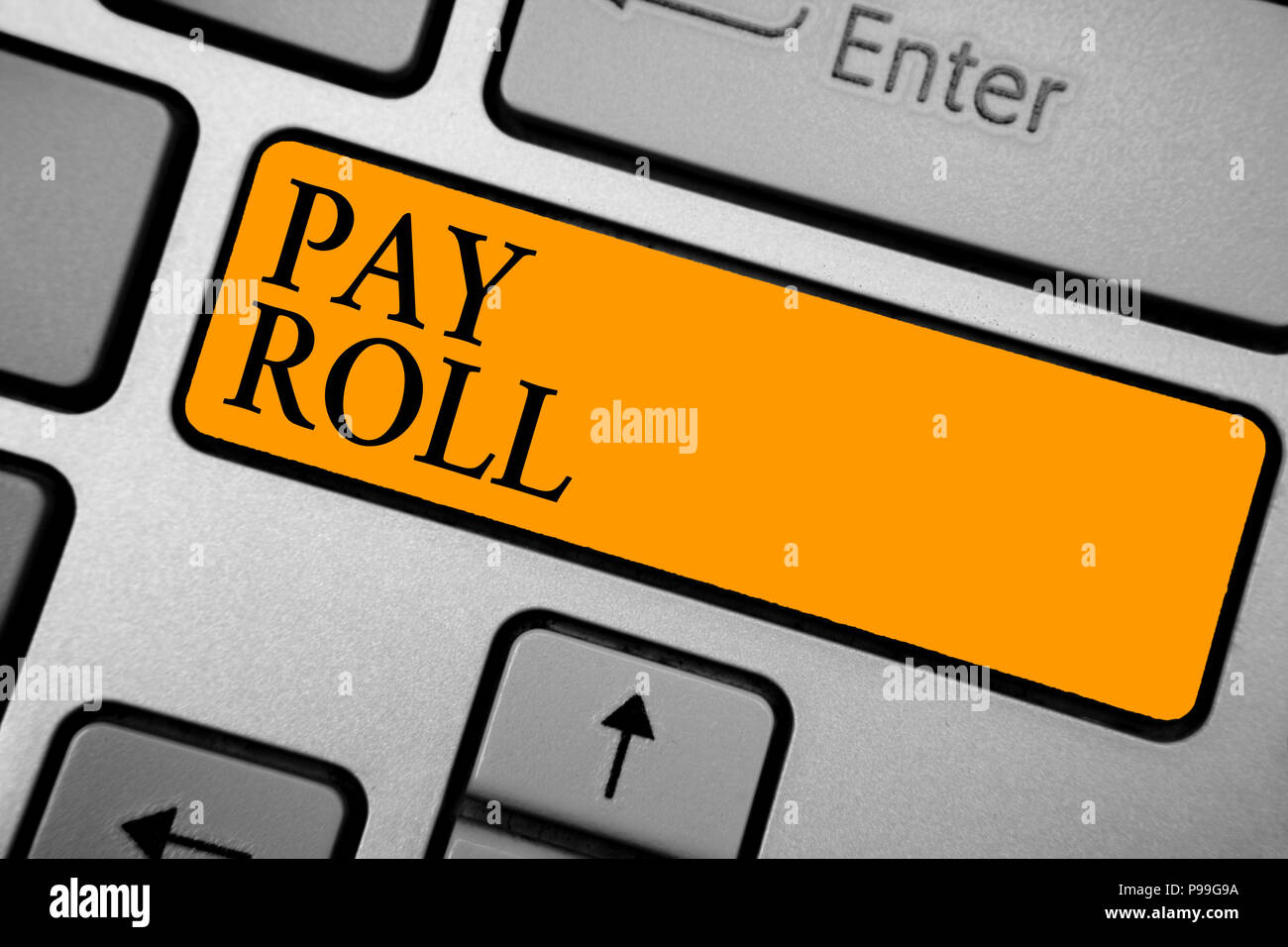 Text sign showing Pay Roll. Conceptual photo Amount of wages and salaries paid by a company to its employees Keyboard orange key Intention create comp - Stock Image