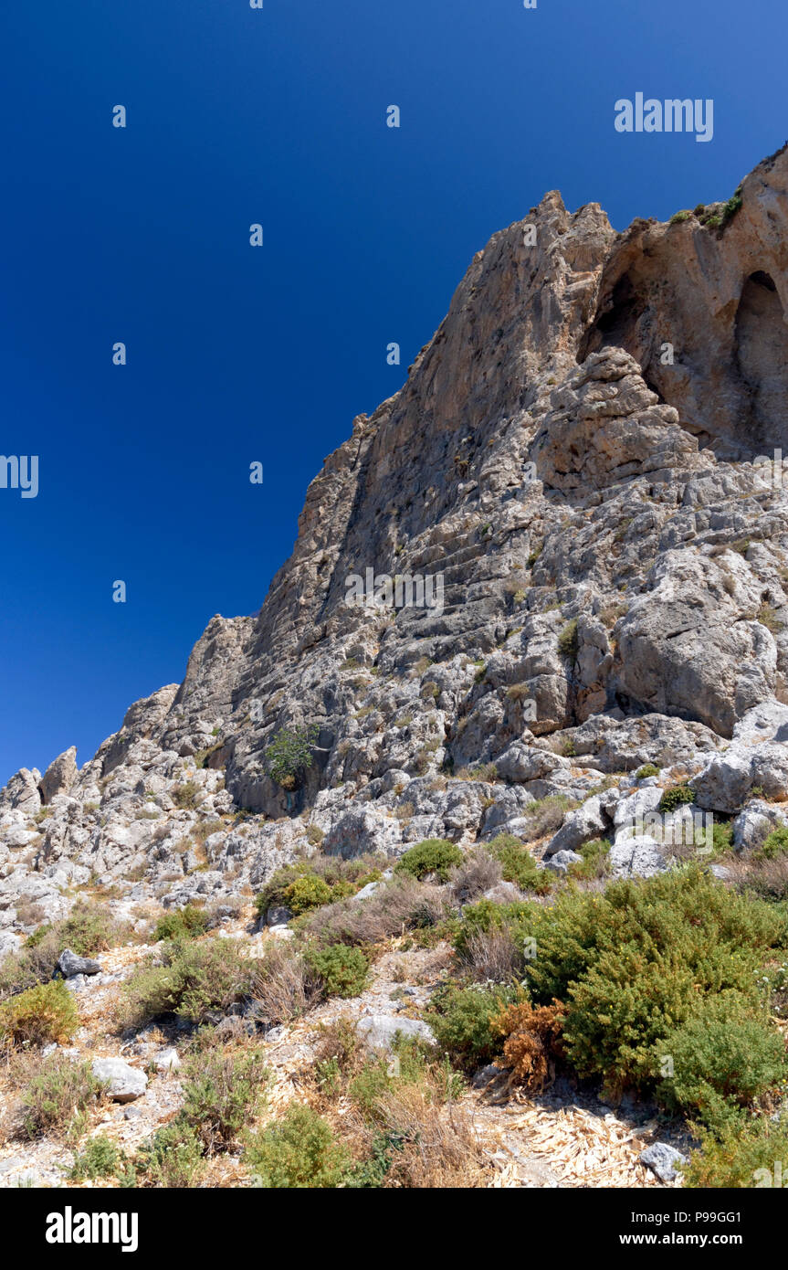 Remains of the 4th century BC kastri or little castle, on the hills above the village of Emborios, Kalymnos, Dodecanese Islands, Greece. - Stock Image