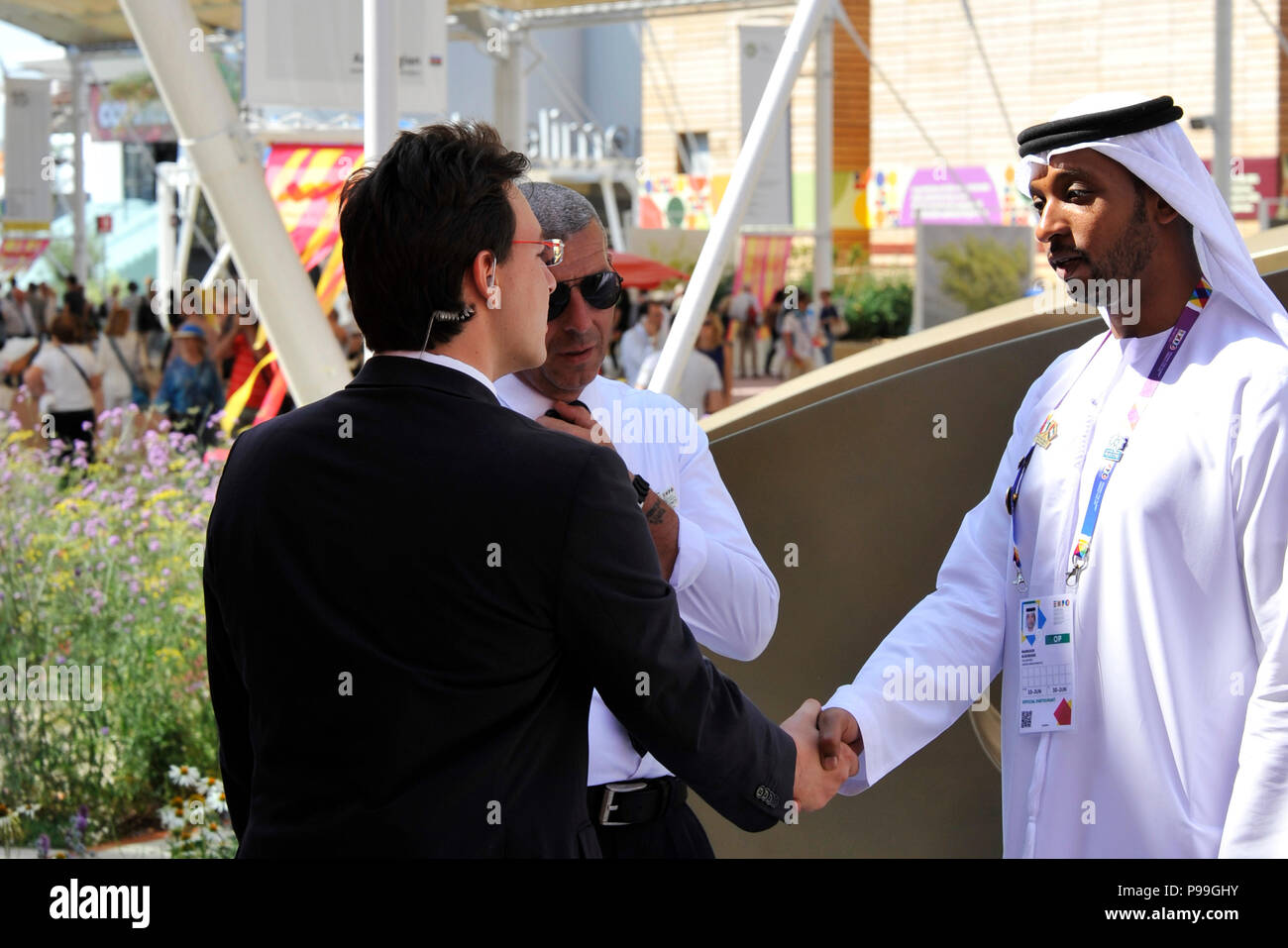 Milan, Italy – July 30 2015: An Arab man and a western man shake hands as a sign of peace. the concept of peace in the world or a concluded world affa - Stock Image