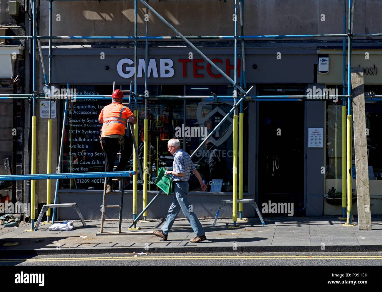 Scaffolding around shop, England UK - Stock Image