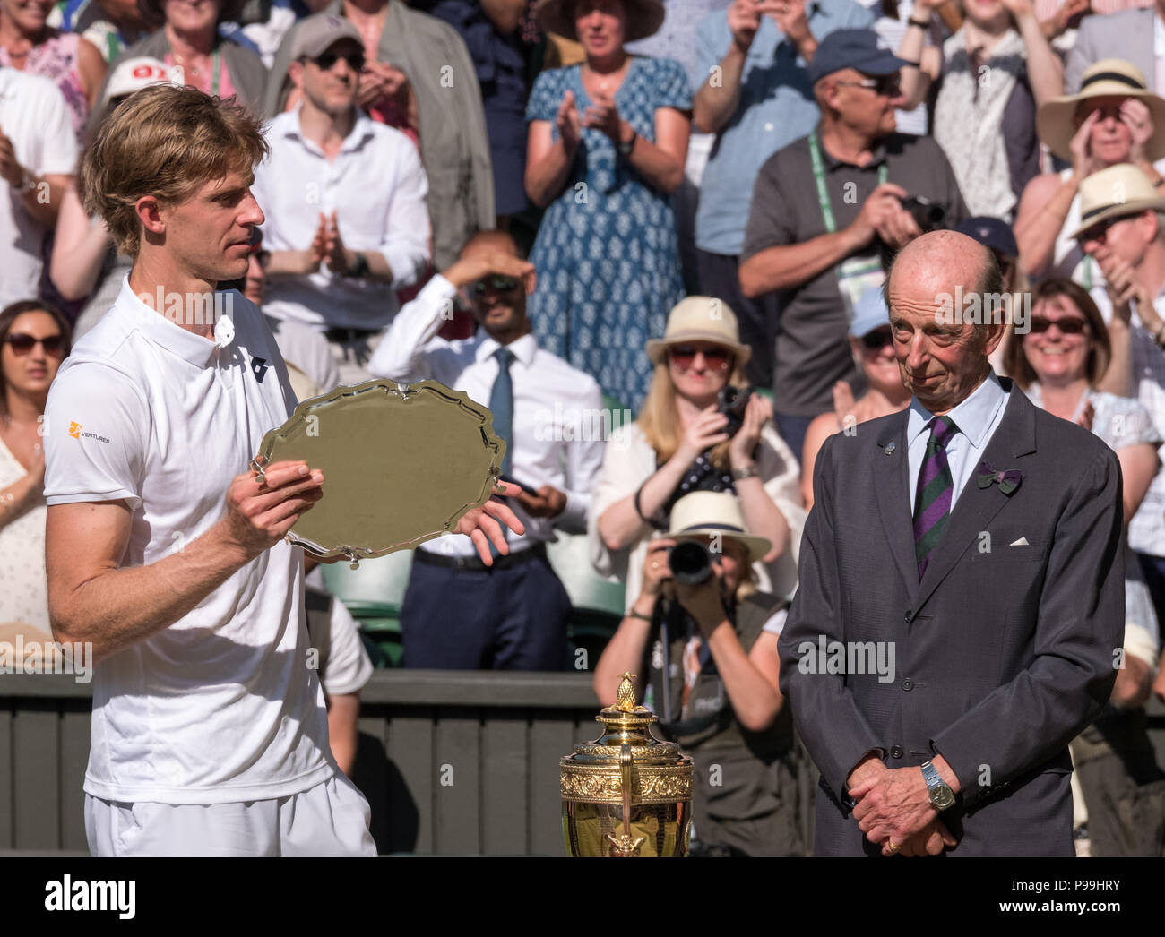 Wimbledon London, July 2018. Kevin Anderson holds his plate on centre court as runner up in the Wimbledon mens finals. The Duke of Kent looks on. - Stock Image