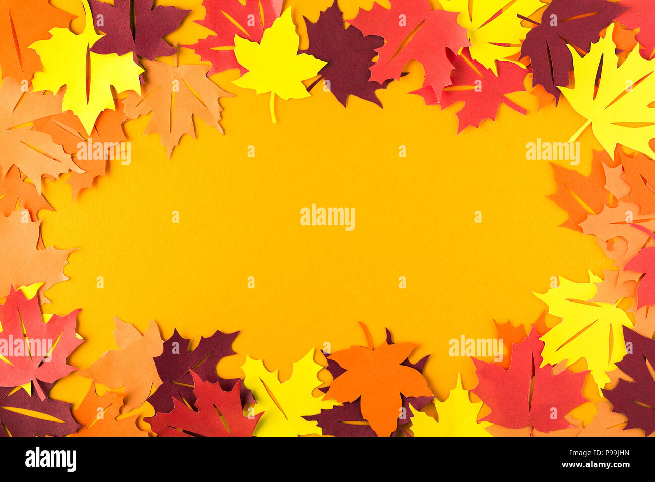 Frame of autumn maple leaves on orange paper. Flat lay. Top view ...