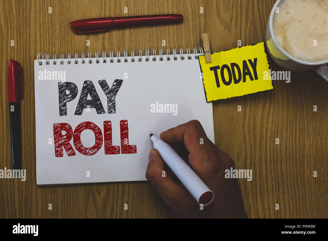 Word writing text Pay Roll. Business concept for Amount of wages and salaries paid by a company to its employees Man holding marker notebook wooden ta - Stock Image