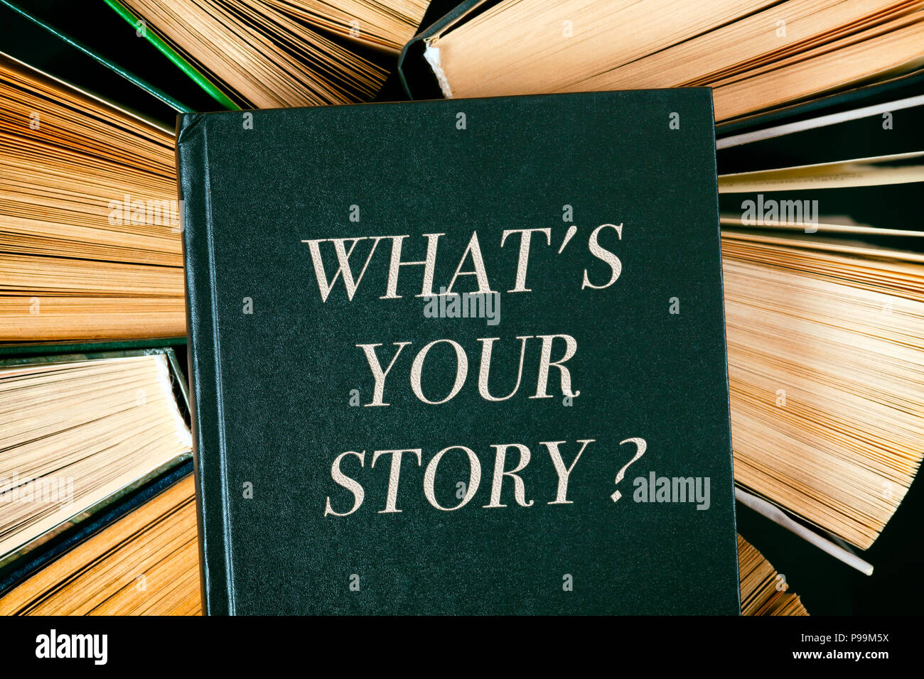 Top view of old hardcover books with book Whats your story? on top. - Stock Image
