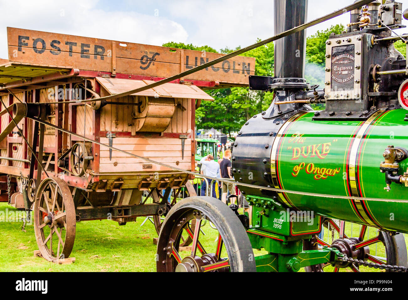 Victorian steam engine 'Duke of Ongar' operating a threshing machine built by Foster of Lincoln at the Northumberland County Show, May 2018. - Stock Image