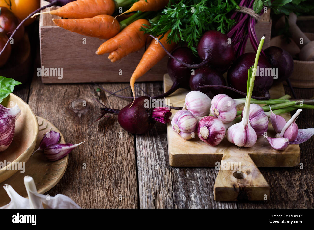 Fresh organic homegrown colofrul vegetables on wooden rustic table, harvest still life - Stock Image