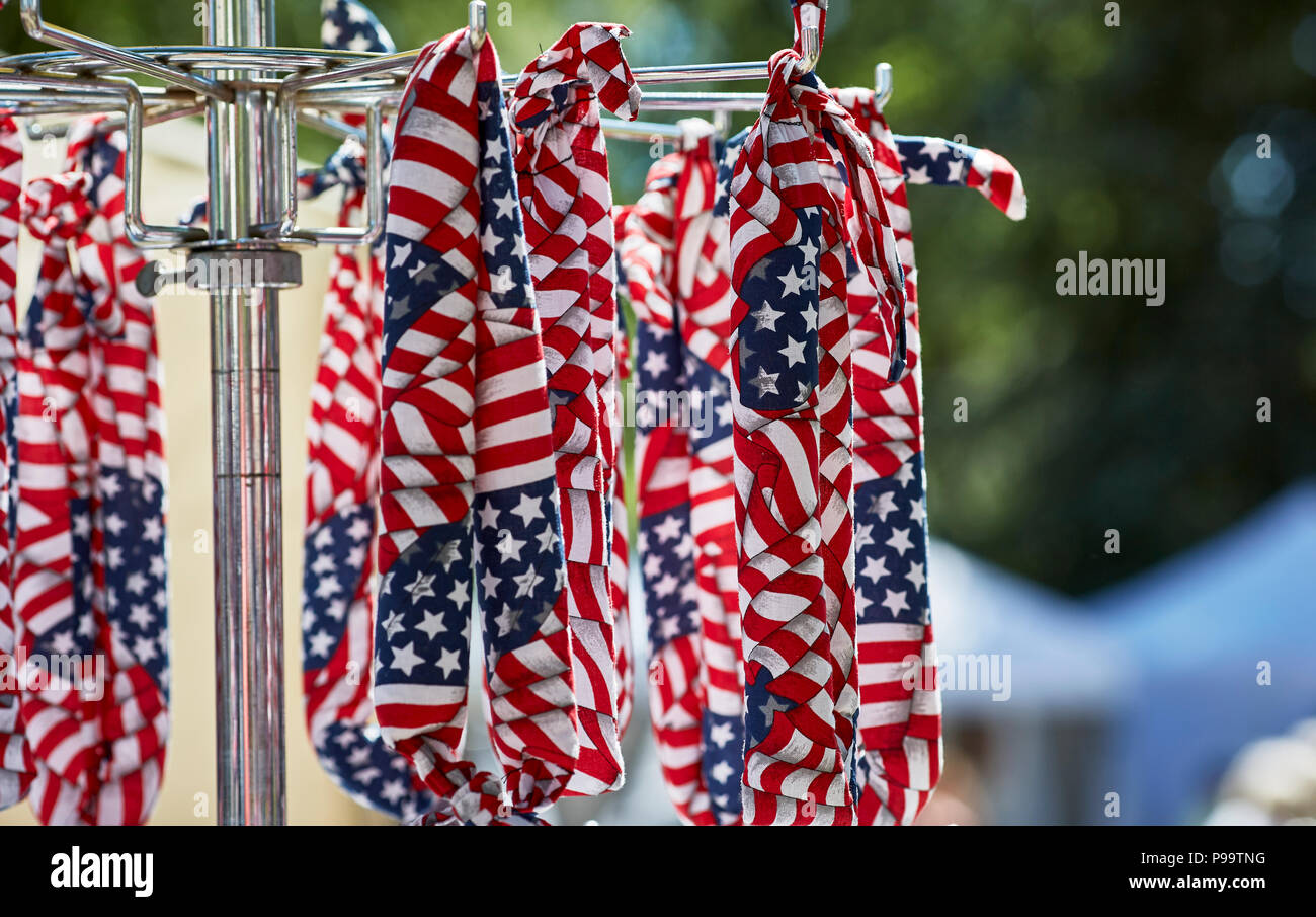 Prescott, Arizona, USA - June 30, 2018: American flag bandanas hanging on rack at 4th of July festival in downtown Prescott - Stock Image