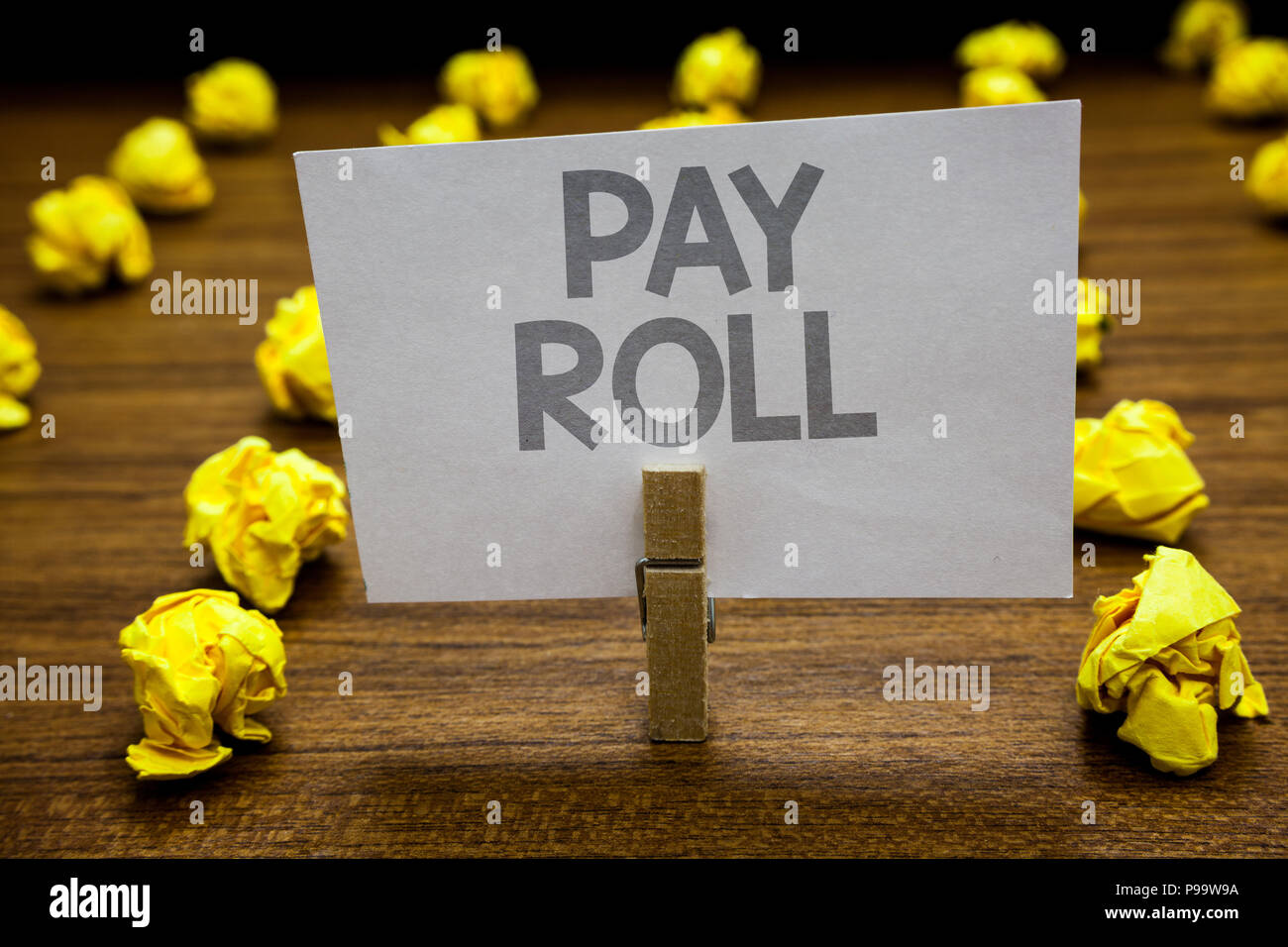 Word writing text Pay Roll. Business concept for Amount of wages and salaries paid by a company to its employees Clothespin hold holding paper idea re - Stock Image