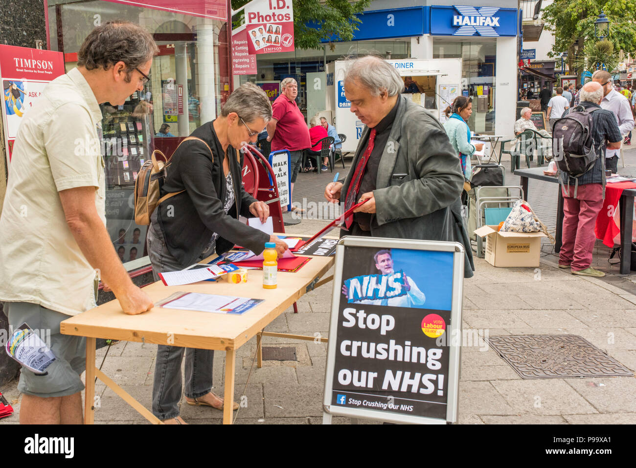 People signing a petition to support the NHS in Ramsgate, Thanet, Kent, England, UK. - Stock Image