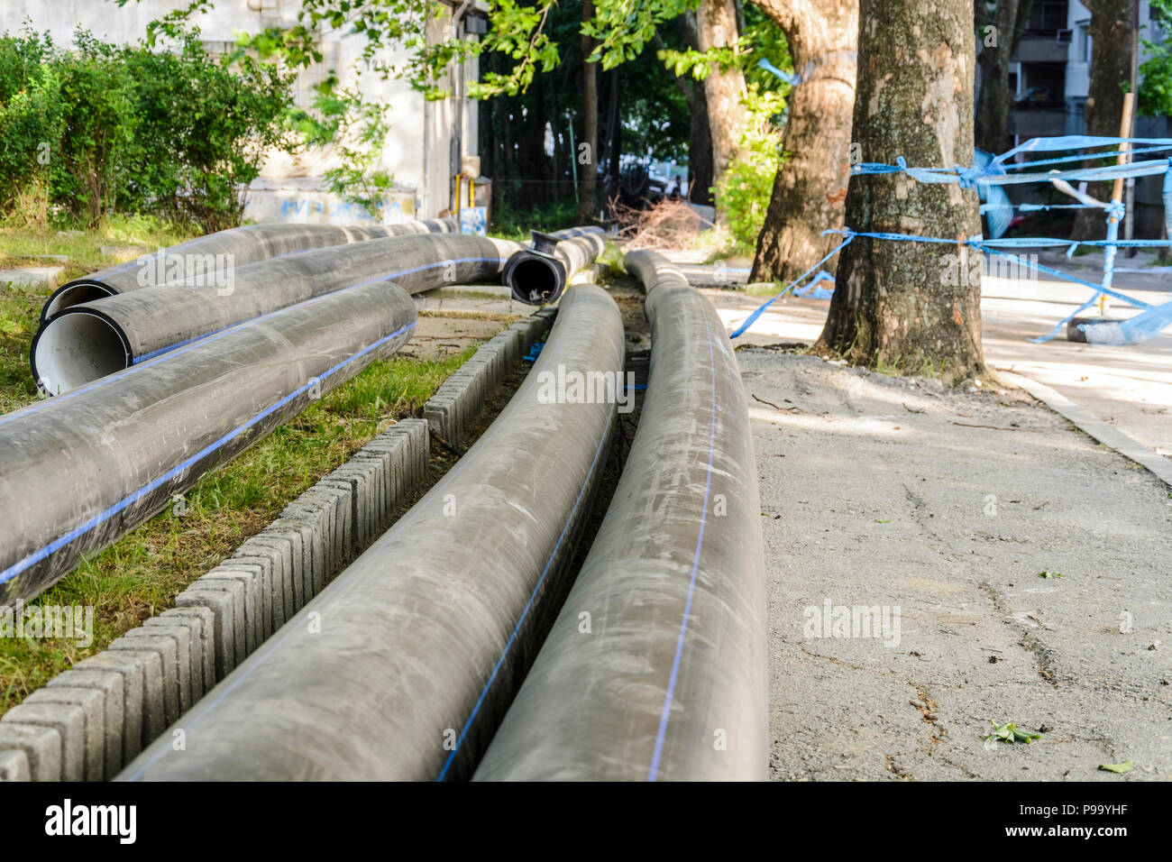 water pipe in a construction site in the middle of the street - Stock Image