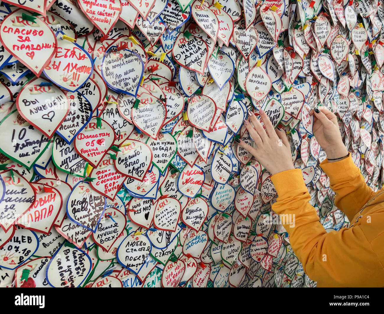 MOSCOW, RUSSIA - JULY, 10, 2018: FIFA Fan Fest Moscow, stickers wall, hands of girl, feelings, love, sport, forecasts. World Cup FIFA 2018, Fan Fest - Stock Image