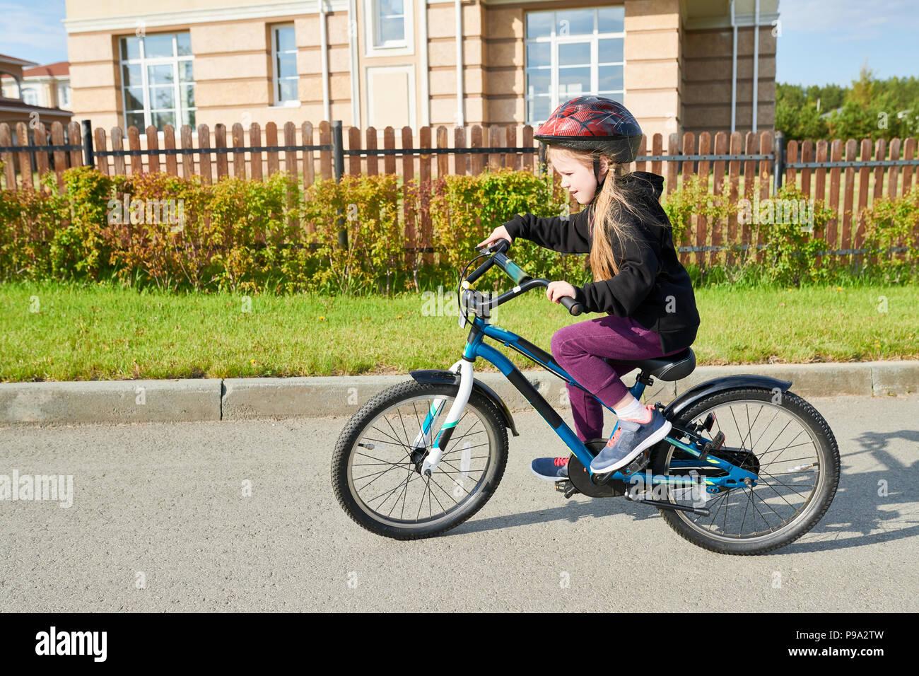 Little Girl Riding Bike - Stock Image