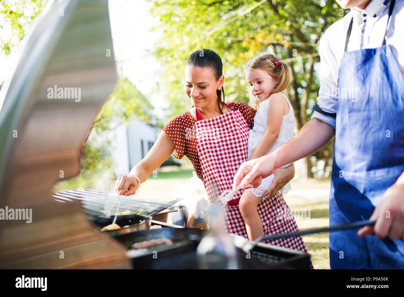 Family celebration or a barbecue party outside in the backyard. Stock Photo