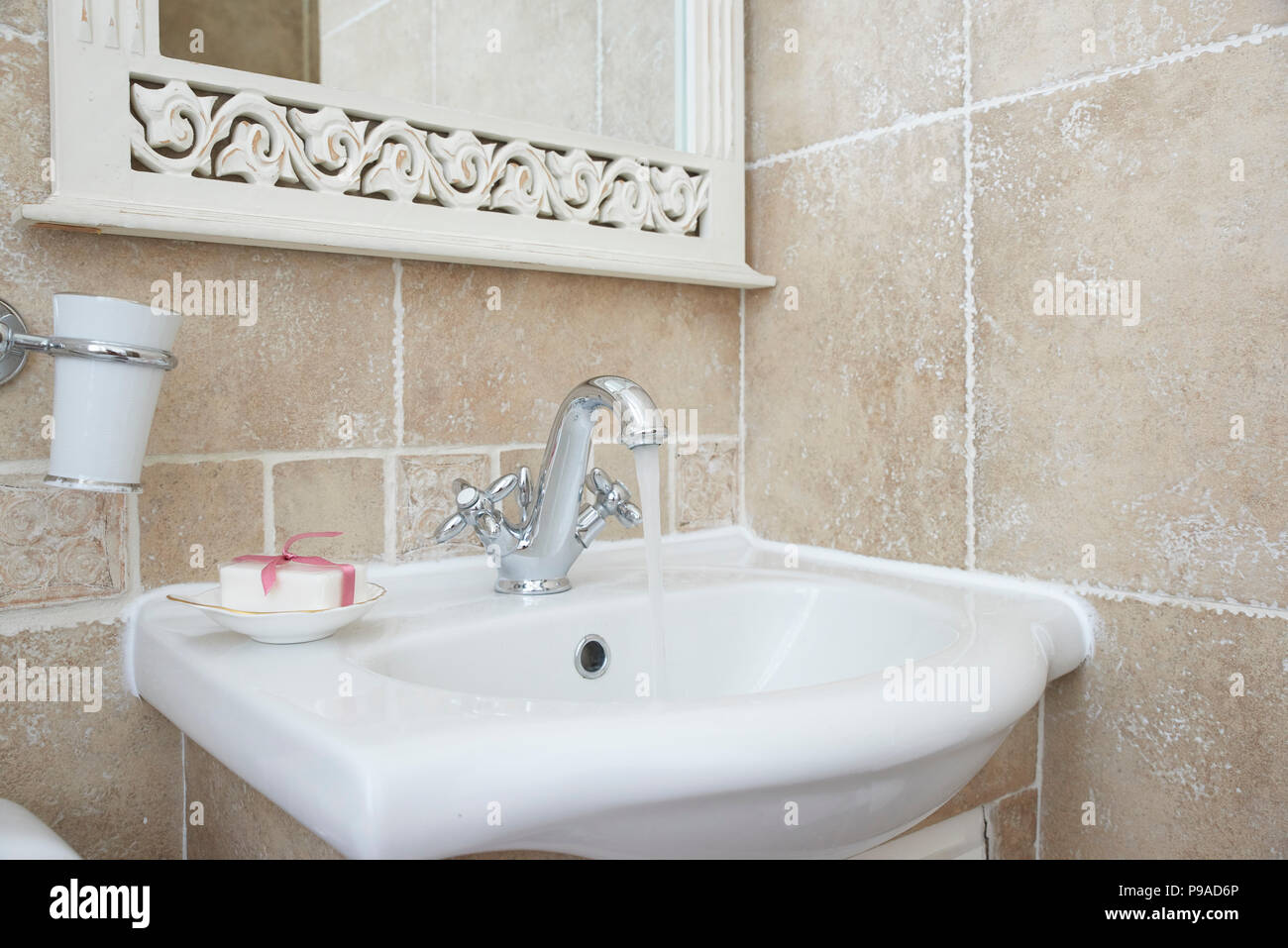 Shot Of Interior Of Bathroom With Sink Basin Faucet Open Chrome