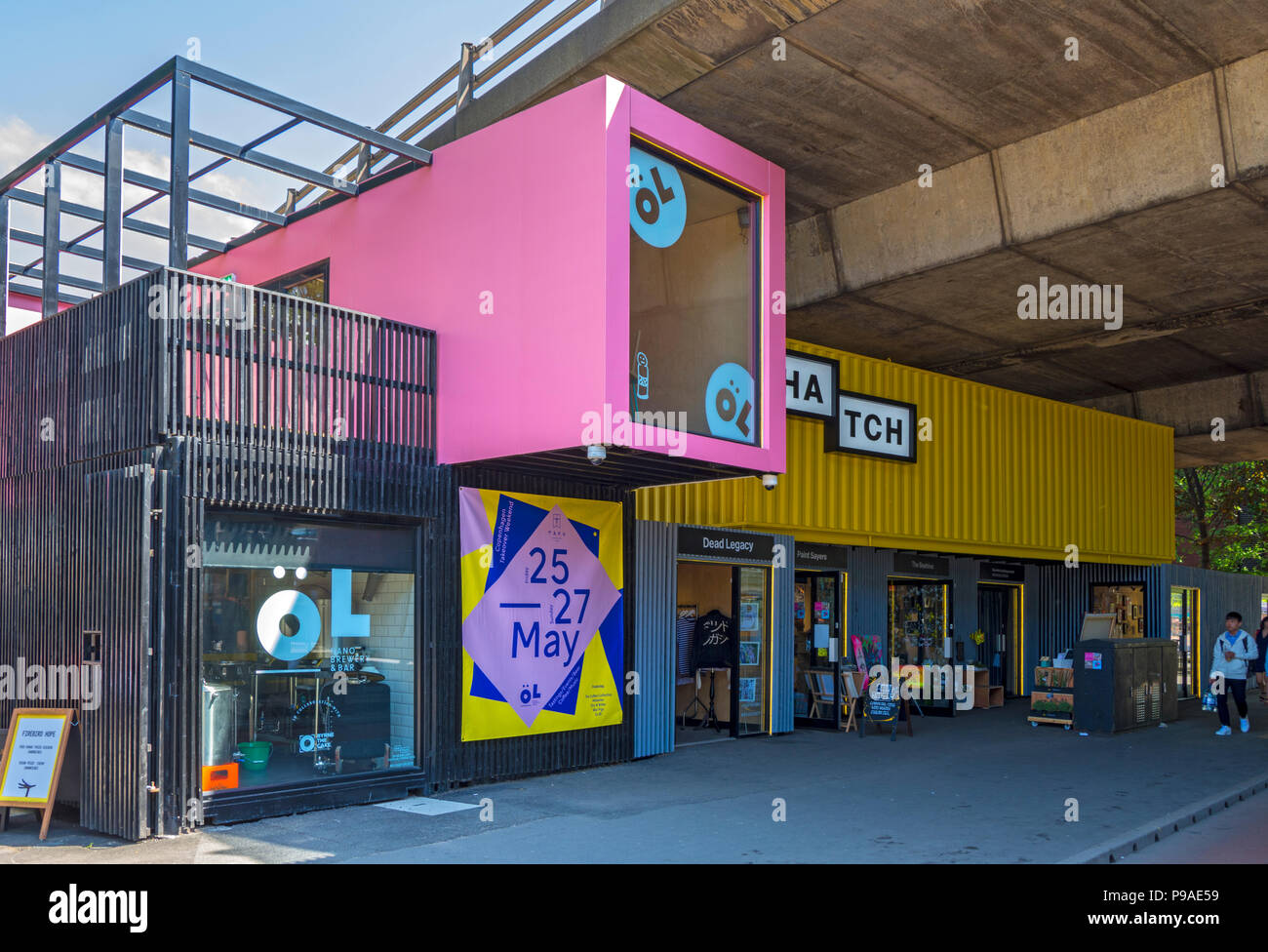 The Hatch, a food and drink outlet built from shipping containers, under the Mancunian Way flyover, Oxford Road, Manchester, England, UK - Stock Image