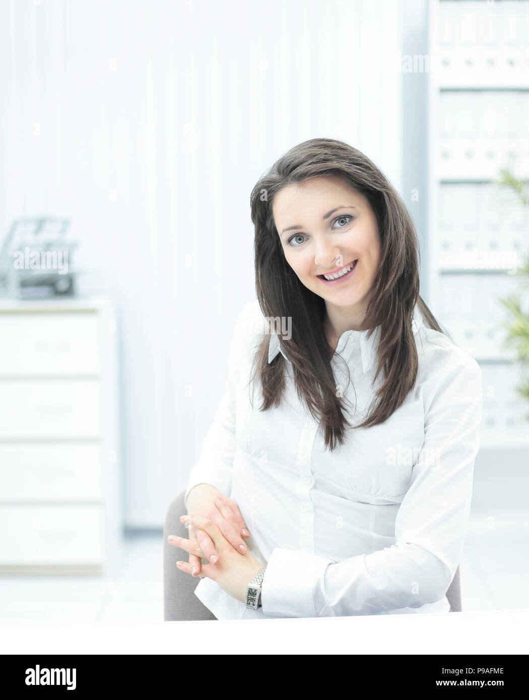 portrait of successful business woman,sitting at her Desk - Stock Image