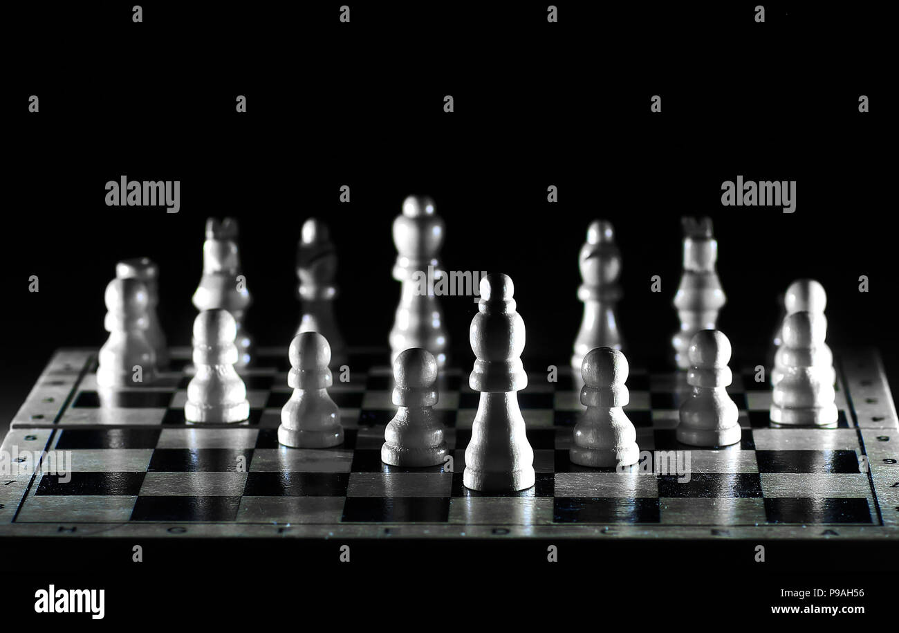 white pieces on a chessboard.photo with copy space - Stock Image