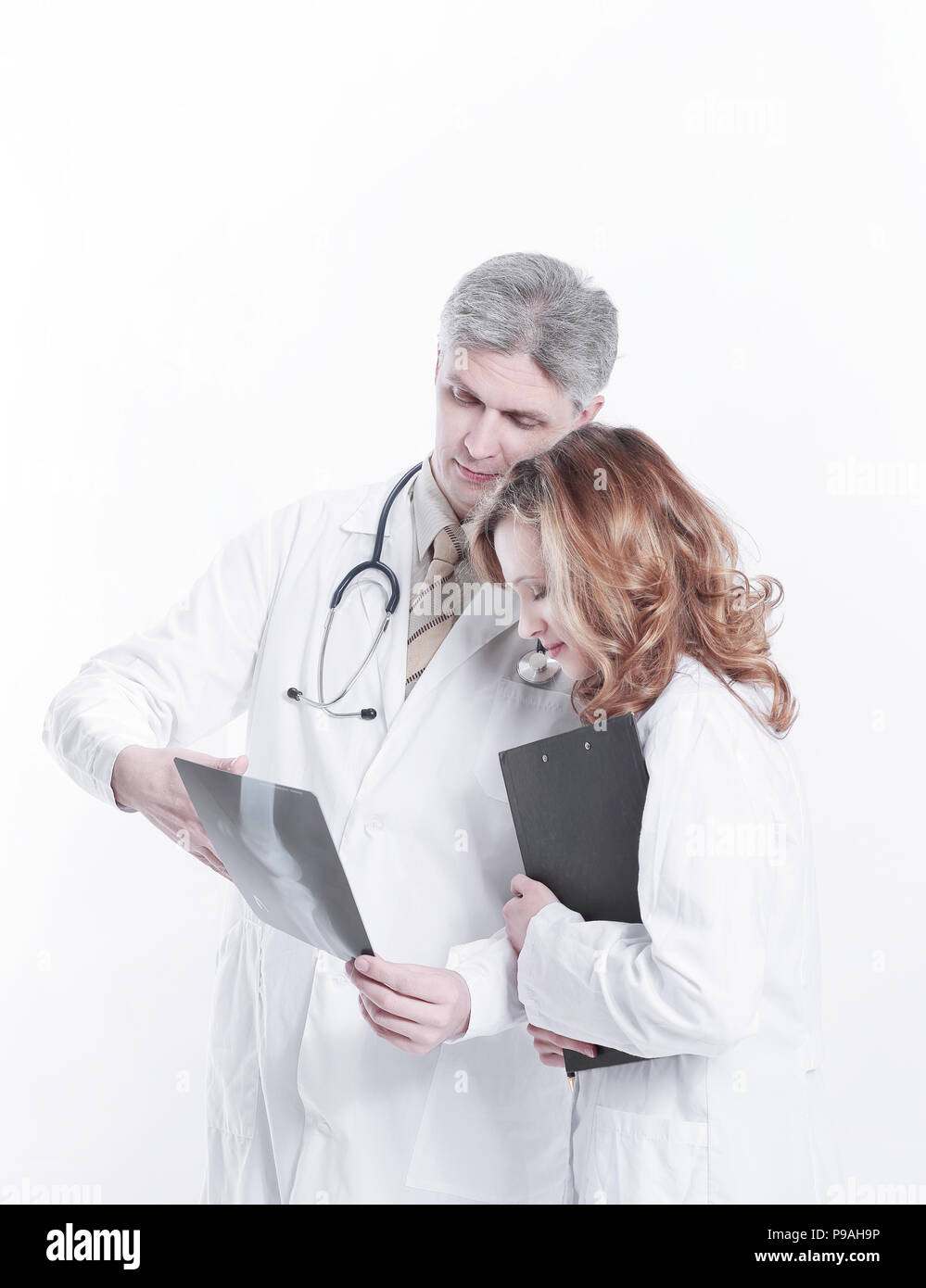 Professional medical team with doctors and surgeon examining patient's x-ray image Stock Photo
