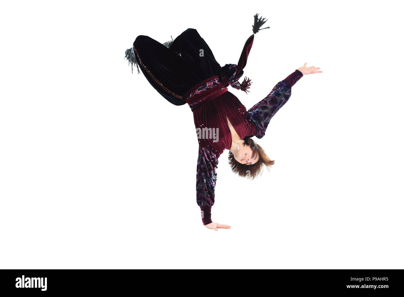 Gypsy male dancer in traditional dress performs folk dance - Stock Image