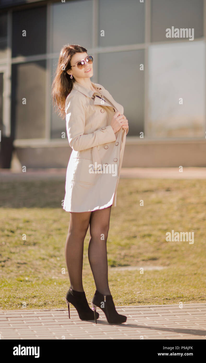 Portrait of a modern business woman on a city background. - Stock Image