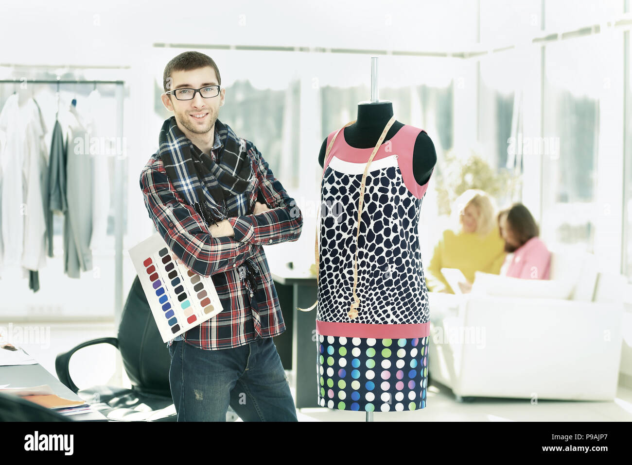 modern designer selects colors for a new collection of clothes - Stock Image