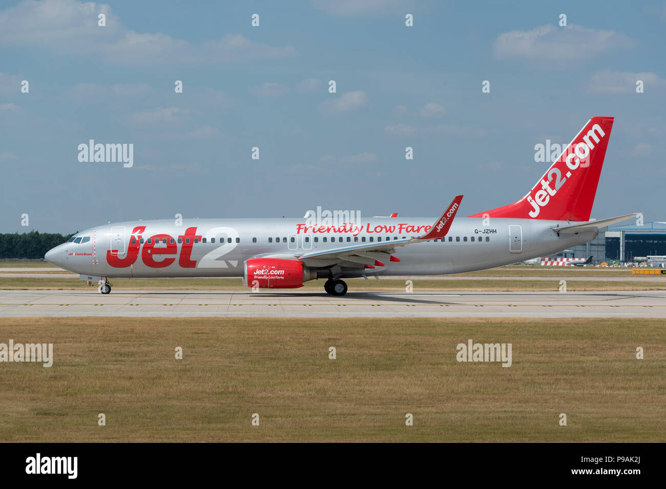 An Jet2 Boeing 737-85P sits on the runway at Manchester Airport as it prepares to take-off. - Stock Image