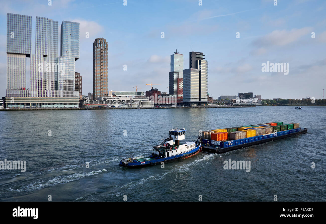 Freight transport in containers by ship on the river the Nieuwe Maas in Rotterdam, Netherlands. - Stock Image